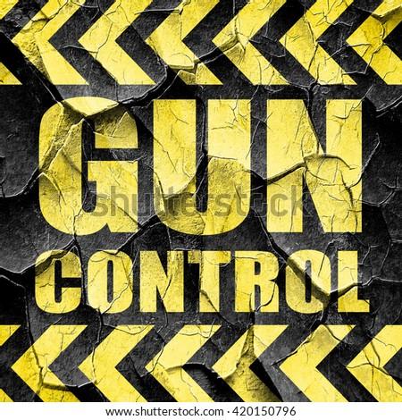 gun control, black and yellow rough hazard stripes - stock photo