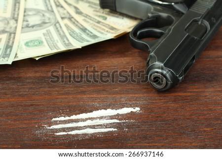 Gun, drugs and money - stock photo
