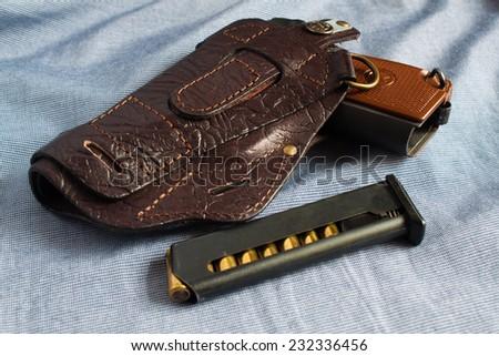 Gun, holster - stock photo