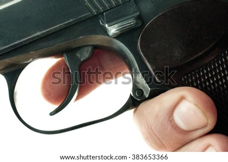 gun in a human hand on a background of old boards - stock photo