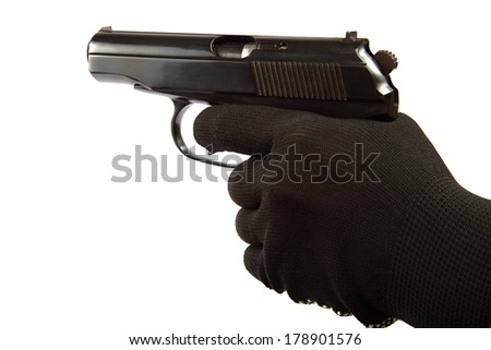 Gun in hand with black gloves isolated on a white background. - stock photo
