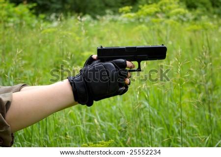 gun in hands - stock photo