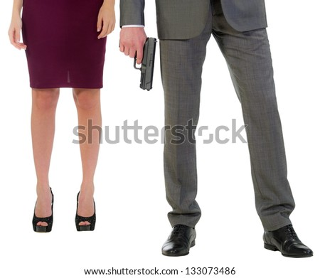 gun in hands of the security guard and female feet isolated on a white background - stock photo