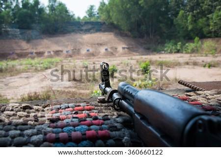 gun in hooting gallery - stock photo