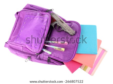 Gun in school backpack, isolated on white - stock photo