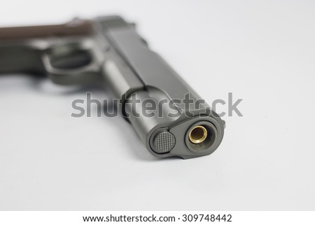Gun isolated on white background / close up and focus on one point and  shallow depth of field