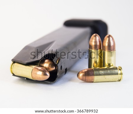 Gun magazine with bullets. Isolated. Close up. - stock photo
