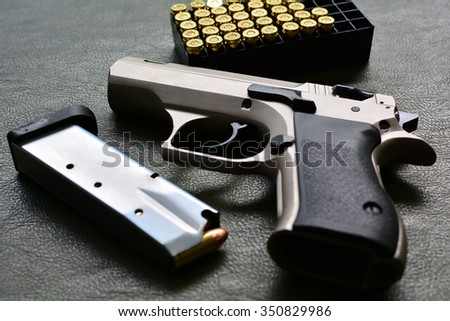 gun 9 mm with rounds - stock photo