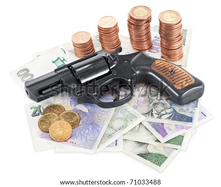Gun on money symbolising money-related criminality. - stock photo