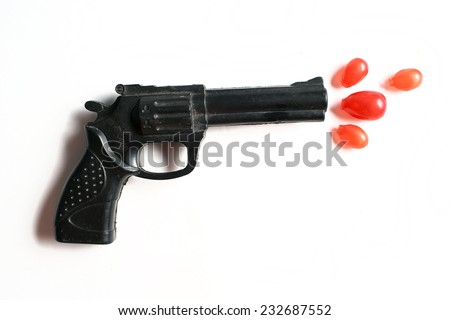 gun on the white background with bullets - stock photo