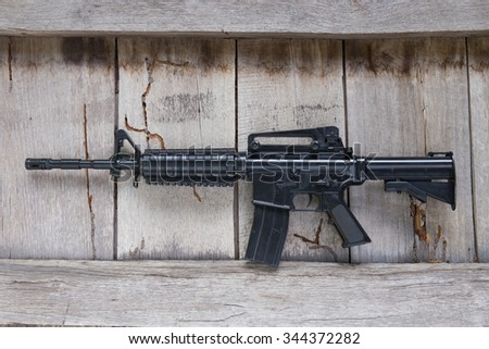 gun toy on wood background - stock photo