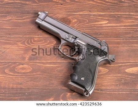 gun with wood background  - stock photo