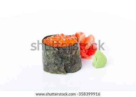 Gunkan sushi stuffed with red salmon caviar. Served with heap of ginger and wasabi. Macro. Can be used as a whole background.