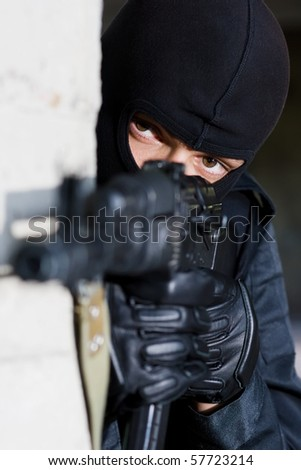 Gunman aiming his target with an automatic russian AK-47 rifle - stock photo