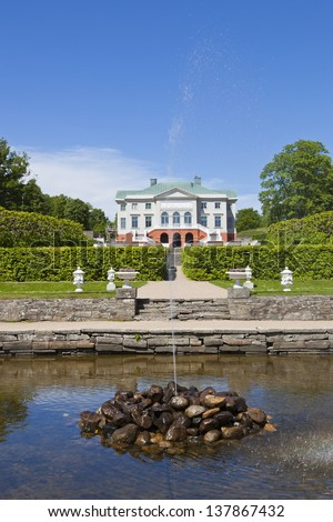 Gunnebo Castle garden in Mondal, Sweden. with trimmed trees along the garden path - stock photo