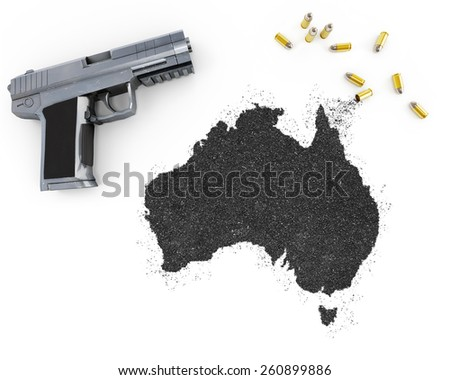 Gunpowder forming the shape of Australia and a handgun.(series) - stock photo