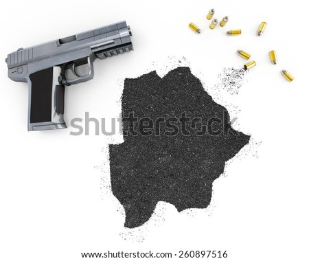 Gunpowder forming the shape of Botswana and a handgun.(series) - stock photo