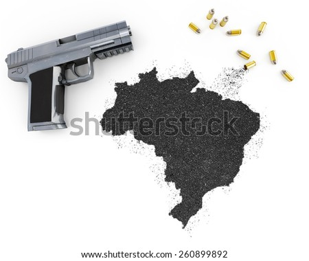 Gunpowder forming the shape of Brazil and a handgun.(series) - stock photo