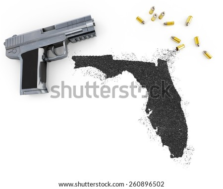 Gunpowder forming the shape of Florida and a handgun.(series) - stock photo