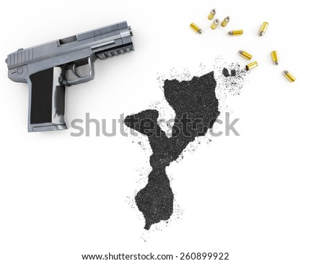 Gunpowder forming the shape of Mozambique and a handgun.(series) - stock photo