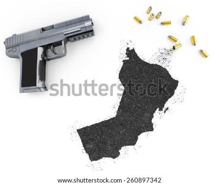 Gunpowder forming the shape of Oman and a handgun.(series) - stock photo