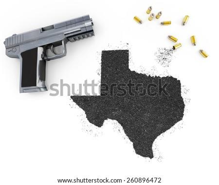 Gunpowder forming the shape of Texas and a handgun.(series) - stock photo