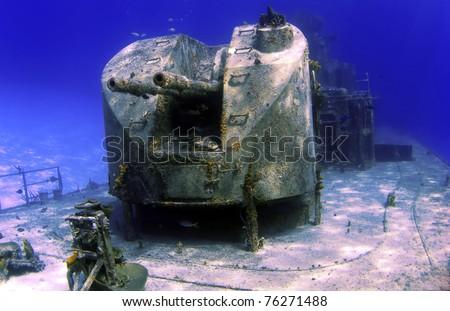 Guns on a sunken shipwreck in Cayman Brac - stock photo