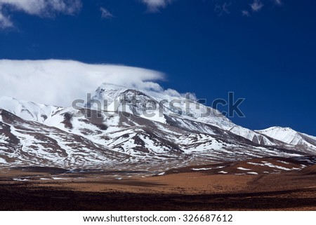 Gurla Mandhata Mount. Gurla Mandhata is the highest peak of the Nalakankar Himal, a small subrange of the Himalaya. It lies in Burang County of the Ngari Prefecture in Tibet Autonomous Region of China - stock photo