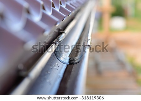 gutter on a metal roof - stock photo