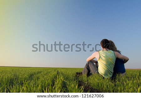 guy and girl in the field - stock photo