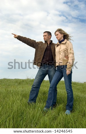 guy and girl on a spring field - stock photo
