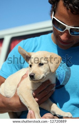 guy and his dog - stock photo