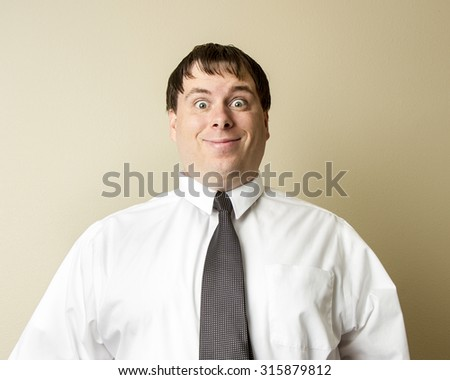 Guy at the office with a huge smile on his face that looks creepy - stock photo