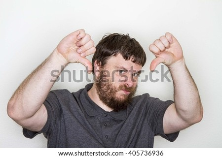 Guy disappointed about something so he gives the thumbs down - stock photo