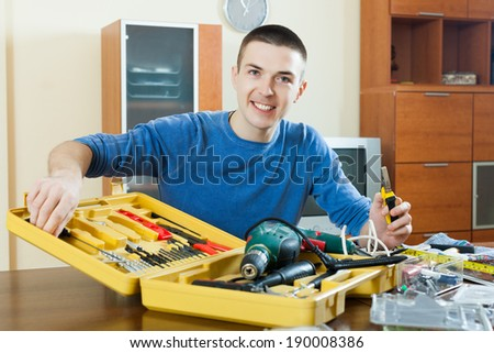 guy doing something with working tools in home - stock photo