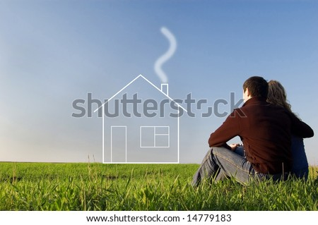 guy embraces girl on a spring field and dreams about home. Low foreshortening - stock photo
