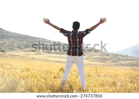 Guy enjoying in nature - stock photo