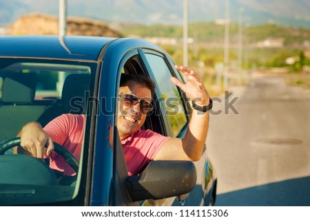 Guy gesturing out of the window of his car - stock photo