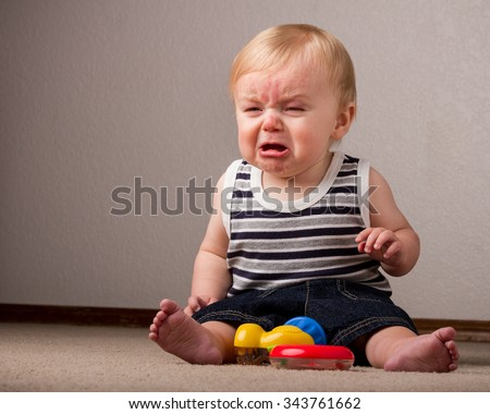 Guy getting frustrated with his little toys - stock photo