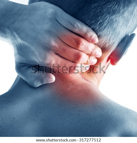 Guy has pain in the back - stock photo