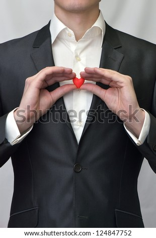 Guy holding a decorative red heart. Idea of Valentine's Day - stock photo