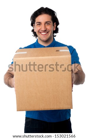 Guy holding cardboard box, relocation concept. - stock photo