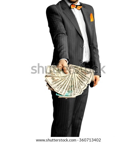 guy in an elegant suit with a bunch of money in the hands. Business concept - stock photo