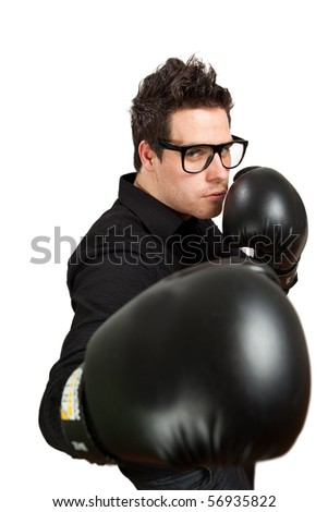 Guy in glasses wearing boxing gloves. Isolated on white - stock photo
