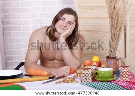 guy in the kitchen in the morning in shorts