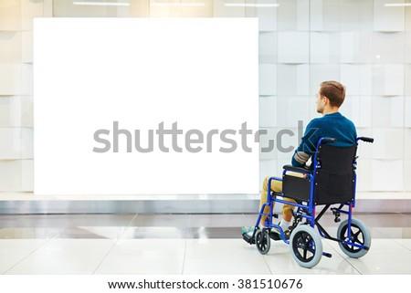 Guy in wheelchair - stock photo