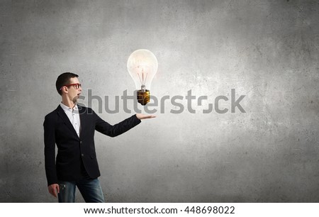 Guy presenting bright idea . Mixed media