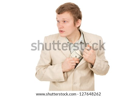 guy puts the money in his pocket and looks around isolated on white background - stock photo