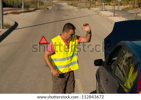 Guy really fed up with his broken down clunker - stock photo