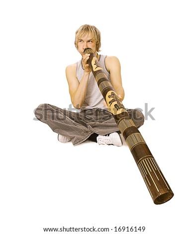 Guy's playing  didgeridoo - stock photo